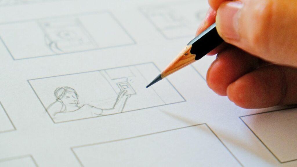 Sketching a storyboard using a pencil.