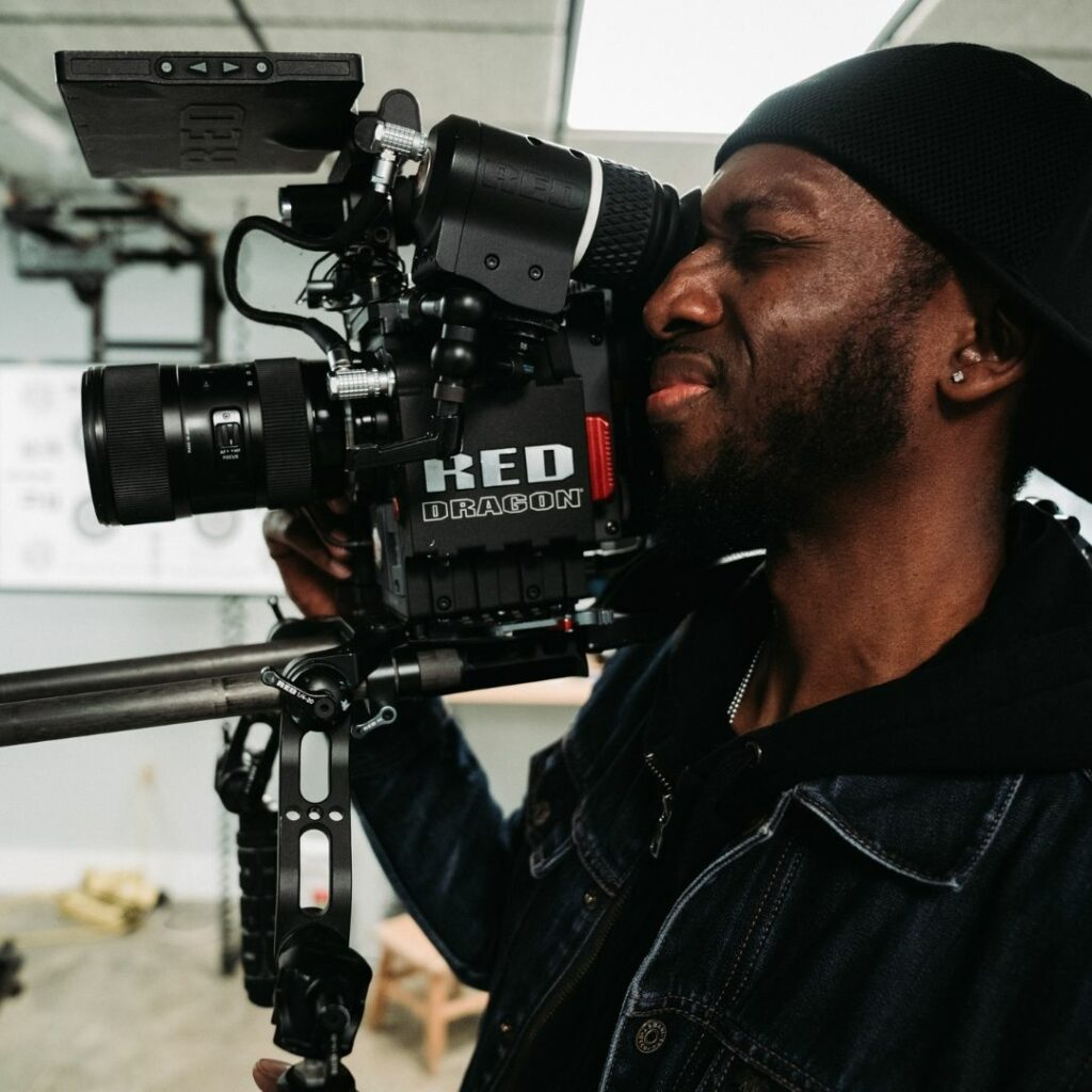A male cinematographer in the action.